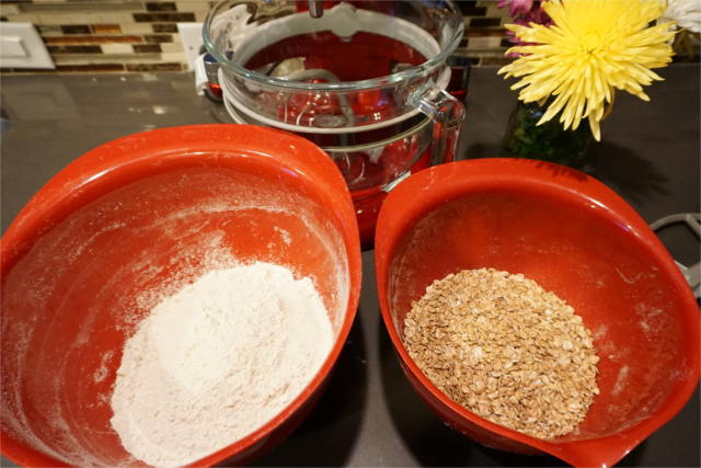 spelt flour and spelt flakes in two mixing bowls