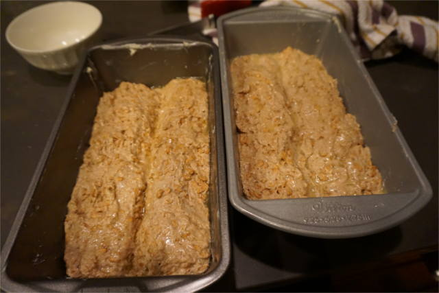 two loaves of spelt bread in baking pans